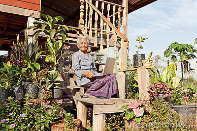 Old asian woman with laptop