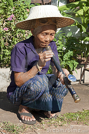 Old Asian woman with opium pipe