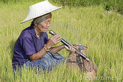 old-asian-woman-with-opium-pipe-thumb106