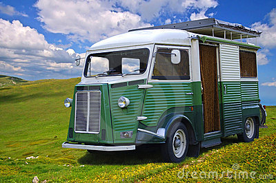 Old auto camper on a background of the blue sky.