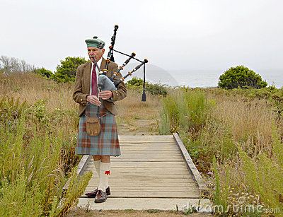 Old bagpiper, including his face