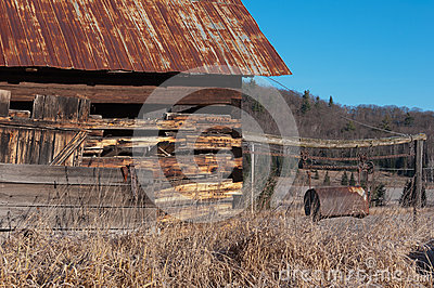 Old Barn with Rusty Manure Bucket