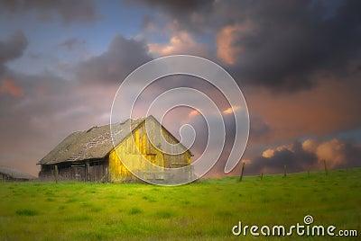 Old barn under dark skies with soft focus