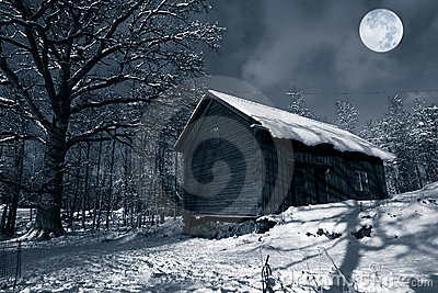 Old barn in winter snow