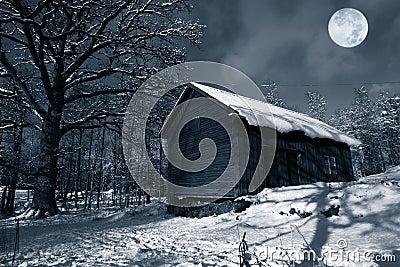 Old barn in winter snow