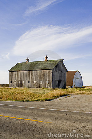 Old barns next to county road in Iowa