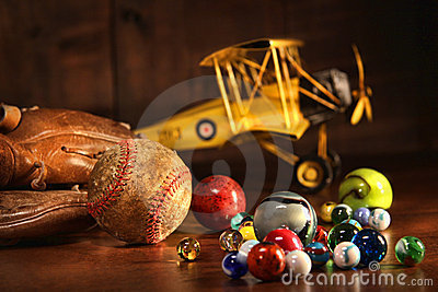 Old baseball and glove with antique toys
