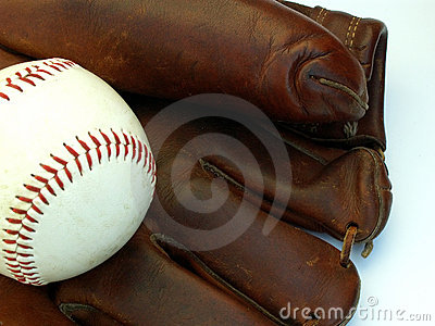 Old baseball glove and ball