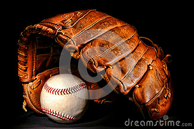 Old Baseball Glove and Professional Ball on Black