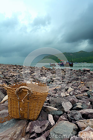 Old basket on the seashore