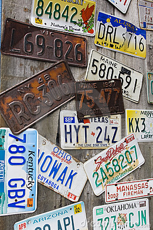 Old and battered car registration plates
