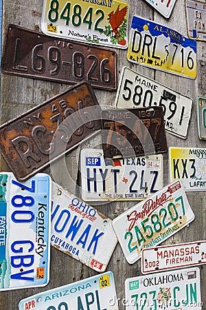 Old and battered car registration plates