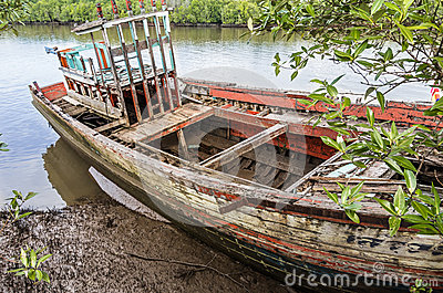 Old beached fishing Boat - Krabi River, Thailand