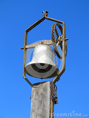 Old church bell on pole