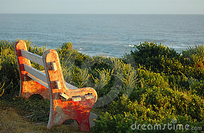 Old bench overlooking sea