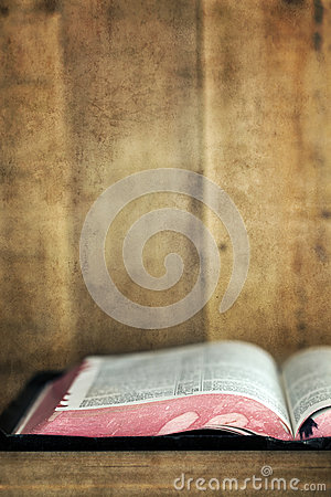 Old Bible Open on Bookshelf with Grunge Effects