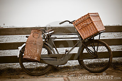 Old bicycle with can and basket