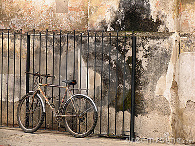 Old bicycle next to an old wall