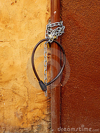 Old bike chains on an old wall