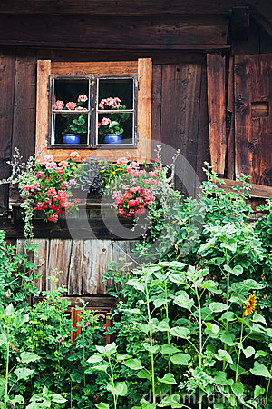 Old block house in Austria with cottage garden