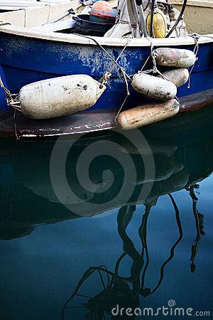 Old Blue  Boat With Floats and Reflections