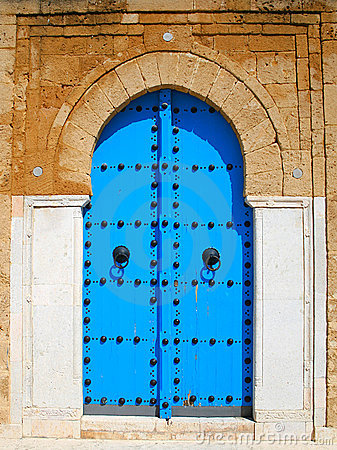Old blue wooden door in tunisian arabic style