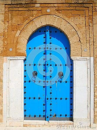 Old blue wooden door in tunisian arabic style