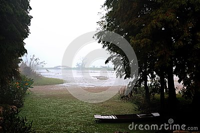 An old boat on the lake  in a rainy day