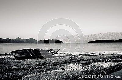 Old boat on Lefkas rocky shoreline