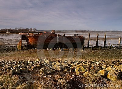 Old Boat shipwreck at sunset