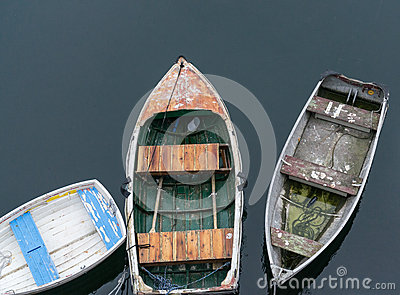 Three boats tied to the dock