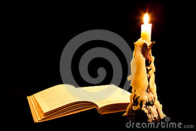 Old book and candle