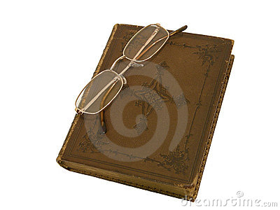 Old book and gold-rimmed spectacles