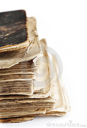 Old book with hard leather cover on white.