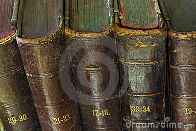 Old book in the light of candles