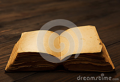 Old book open blank pages, empty paper on wooden table