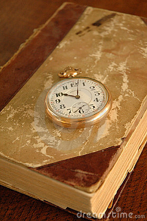 Old book with Pocket Watch