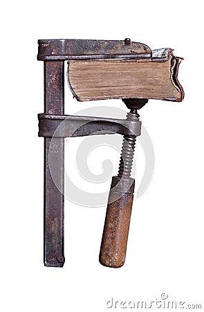 Old book under pressure in clamp