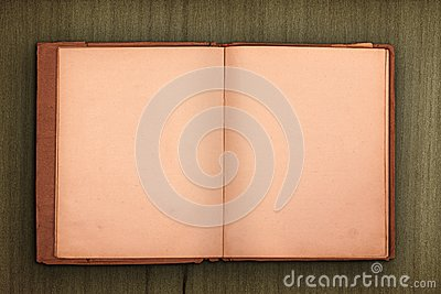 Old book with wooden background