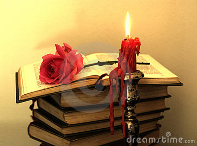 Old books, red rose...