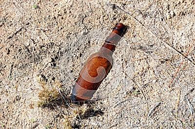 Old bottle in sand