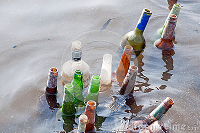 Old bottles float in the river