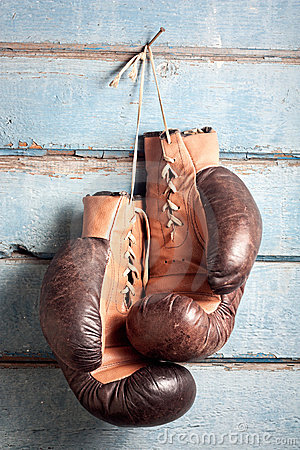 Free Old Boxing Gloves With A Lace Over Blue Wall Stock Images - 18351474