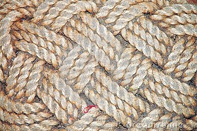 Old braided dirty door-mat