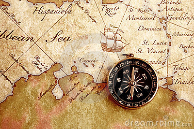 Old brass compass on a Treasure map