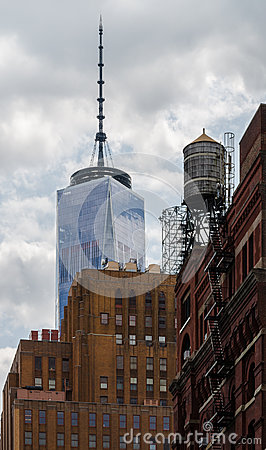 Free Old Brick Building In New York City With World Trade Center Tower In Background Royalty Free Stock Photography - 44535777