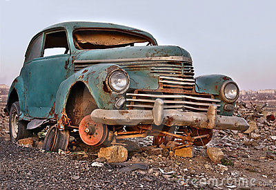 Old broken rusty abandoned car