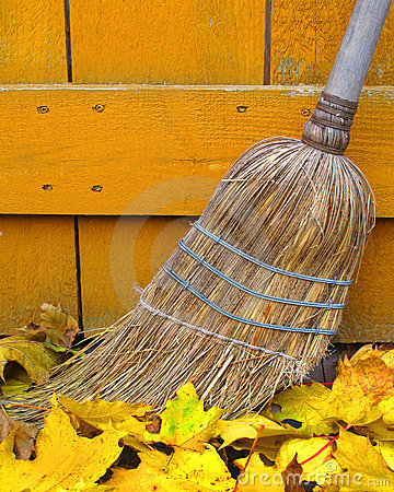 Old broom and autumn leaves