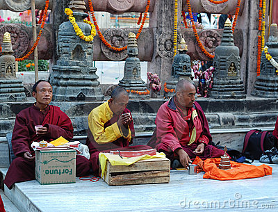 Old buddhistic monks are praying Editorial Image