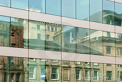 Old building reflected in modern windows